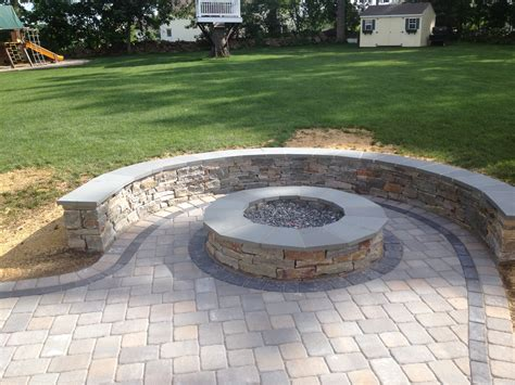 paver pit designs natural stone sitting wall with bluestone cap surrounds a fire pit and paver patio by bahler