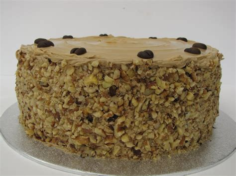 100g unsalted butter 300g icing sugar 10ml espresso strength instant coffee 12 whole walnuts Claire Elizabeth: Coffee and Walnut Cake