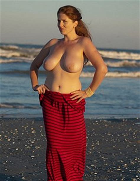 Busty Redhead Sophia Delis Gets Nude At The Beach