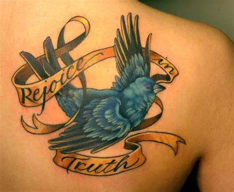 caged  flying bird tattoos  designs