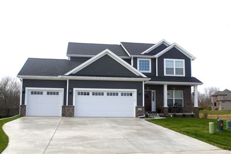 White Garage Doors by White Trim Royal Ironstone Grey Siding And Shakes