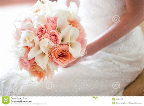 Bride With Orange And Pink Wedding Bouquet Stock Photo