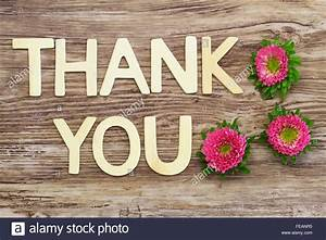 thank you written with wooden letters and pink daisy With thank you wooden letters
