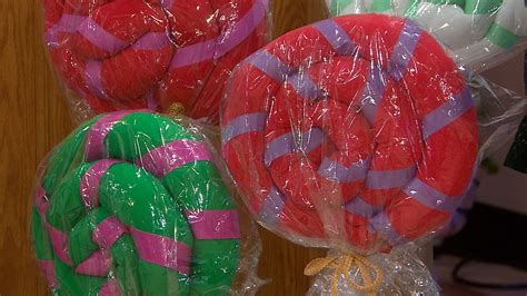 holiday diy decorations giant lollipops curtain rod