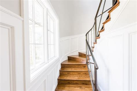 narrow winding staircase  paneled walls transitional