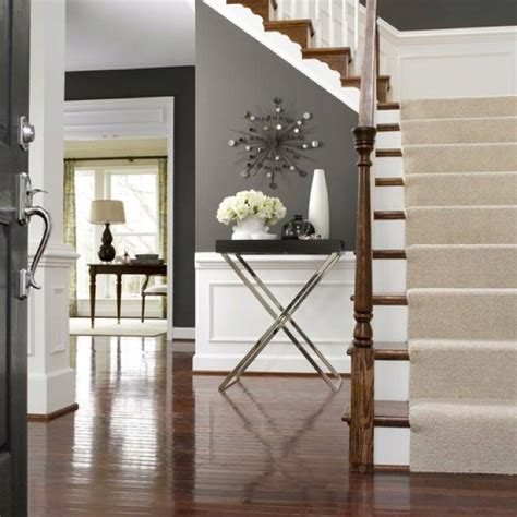 grey walls white trim stairs with neutral runner the