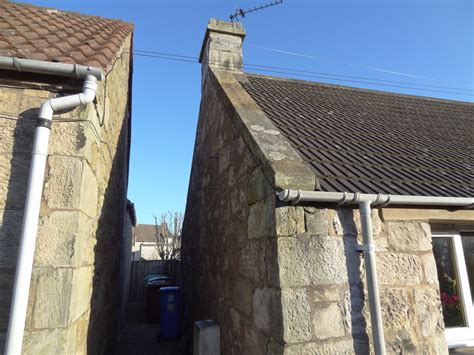 Refresh Pointing On Stone Gable End Wall And Roof Edge