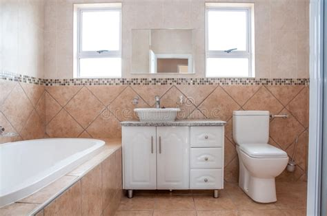 New Bathroom With Bath, Basin, And Toilette Stock Image