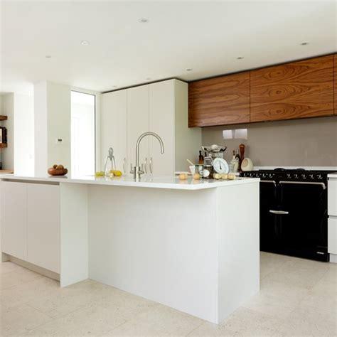 modern white kitchen with black aga housetohome co uk