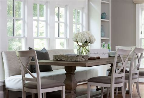 dining table with upholstered bench and chairs