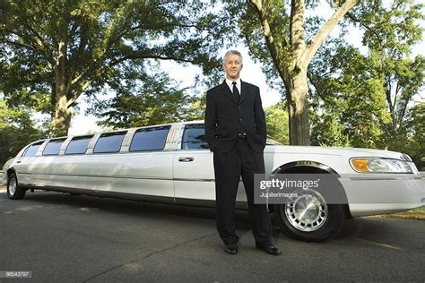 Chauffeur Limousine by Limousine Chauffeur Standing In Suit Stock Photo Getty