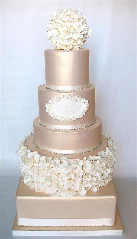 champagne wedding cake design  extravagant gold