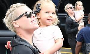 Pink keeps daughter Willow close as they gaze up at ...