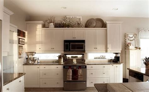 How To Decorate Above Kitchen Cupboards by Above Kitchen Cabinet Decor Cabinets Simple