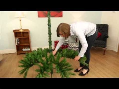 how to fix artificial christmas tree branches assembling and shaping hook in tree