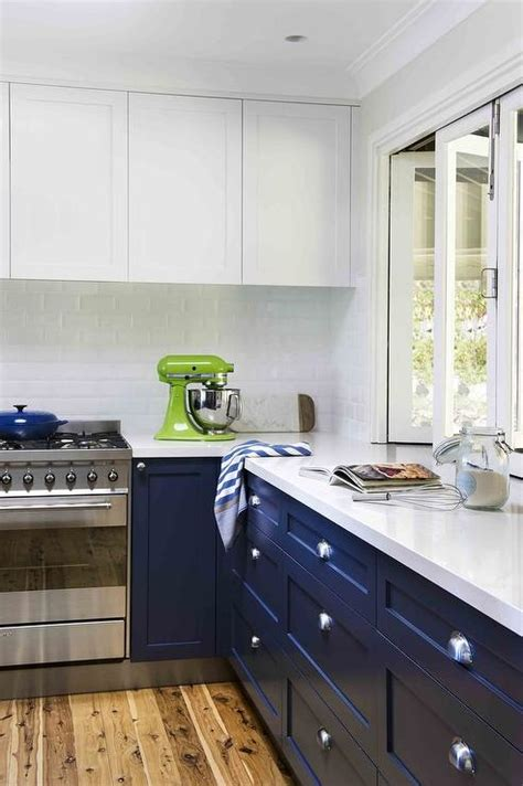 navy  kitchen cabinets  white quartz countertops