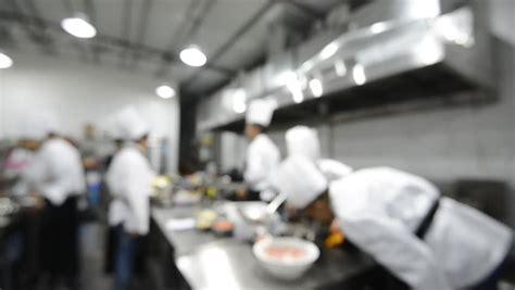 blur background chefs cooking food   restaurant