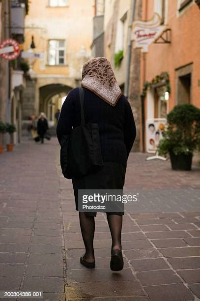 pantyhose senior street walking woman down historical narrow gettyimages