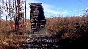 Dump Truck With Straight Pipe Spreading Rock