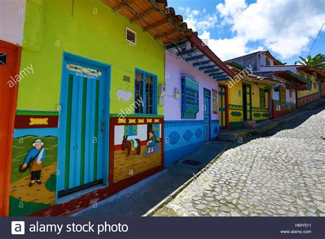 Colorful Colonial by Colorful Colonial Houses And Cobblestone In Guatape
