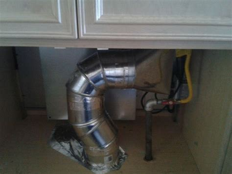 Down draft pipe ventilation beneath a cook top. Looks like