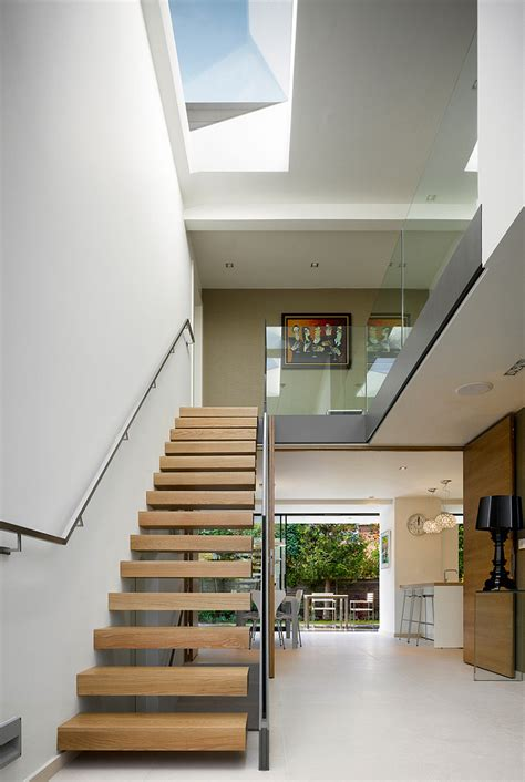open space stairs manchester residence gets a modern makeover encased in warm wooden tones