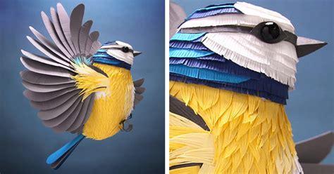 artist creates  paper art sculptures  birds bees