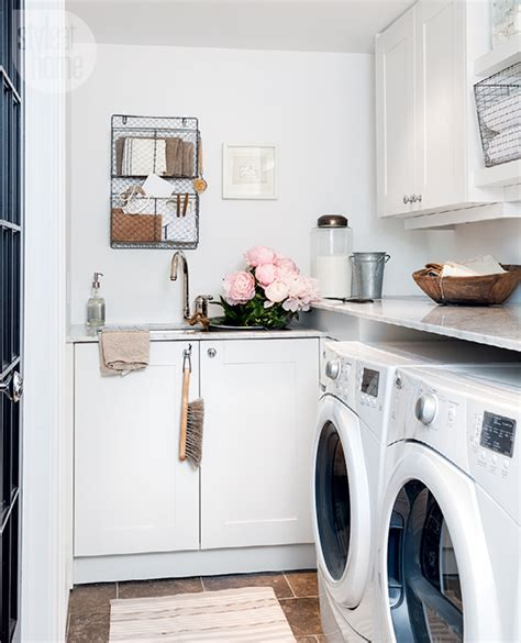 Small White Laundry Room with Sink   Contemporary