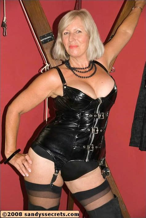 Sandy Spain Wearing Latex Corset And Stockings While