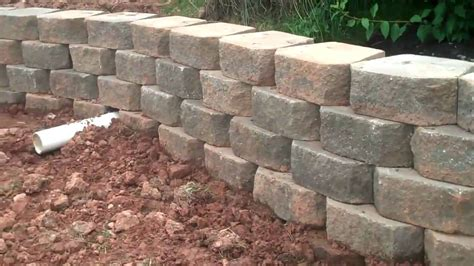 retaining wall with drainage pipe drainage pipe through retaining walls by c o l youtube