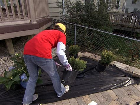 prevent weeds in garden how to prevent weeds with landscape fabric how tos diy