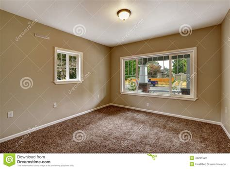 beige empty room with brown carpet floor stock
