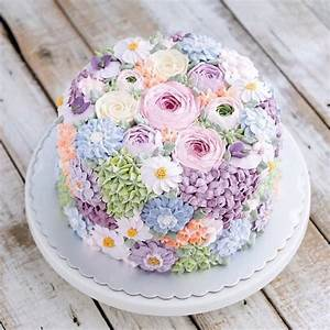 Buttercream wedding cake covered in flowers by Indonesian ...