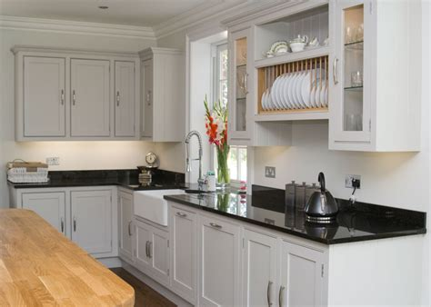 white kitchen with black island beaded shaker kitchen 1830