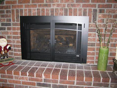gas log insert fireplace gas log fireplace insert kozy heat s chaska gas insert