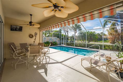 patio  screened     covered lanai  ceiling fans  retractable awning