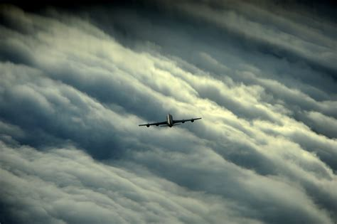 photo airplane storm clouds plane  image