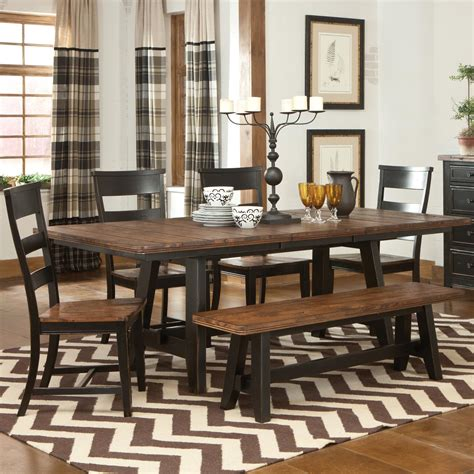 solid wood trestle dining table with ladder chairs and
