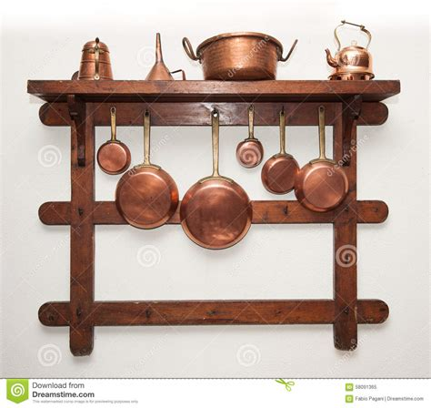 vintage copper cookware hung  wooden shelf stock photo image