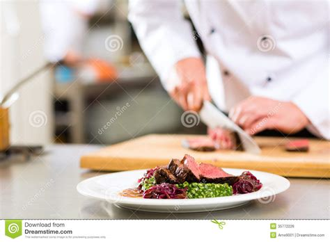 chef cuisine chef in restaurant kitchen preparing food royalty free