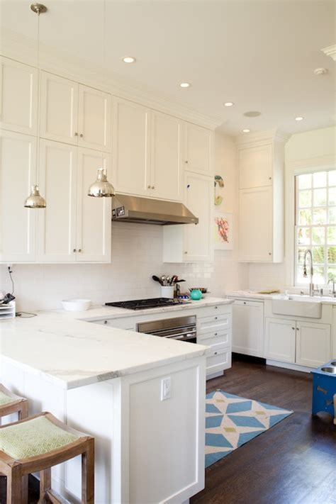 white shaker kitchen cabinets  gold hardware