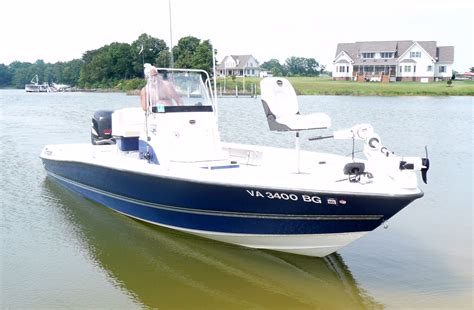 Bay Boats by Price Reduced Triton 240 Lts Flats Bay Boat For Sale