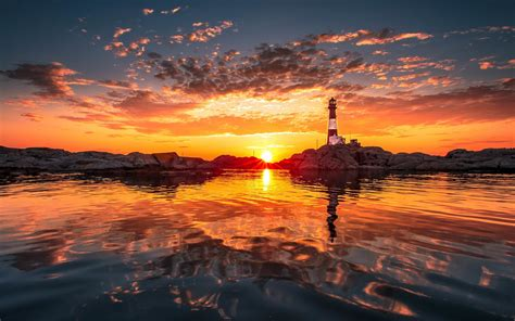 lighthouse water sunset clouds natural lighting
