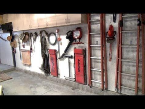 installed  garageshop upper cabinets pegboard