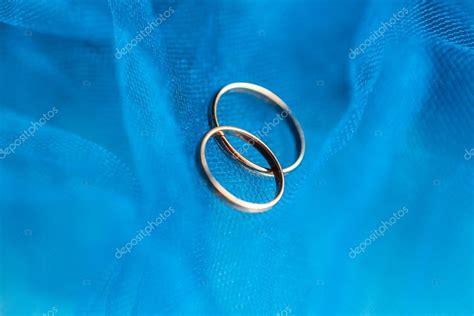 wedding rings   blue background stock photo