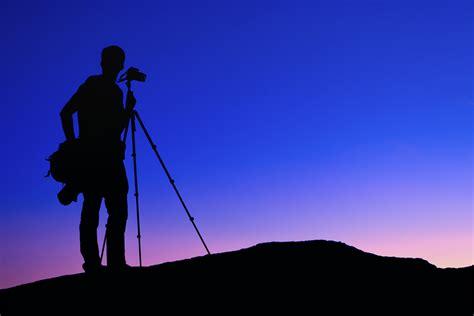 12238 photographer tripod silhouette frame vs crop sensor cameras pros and cons of the