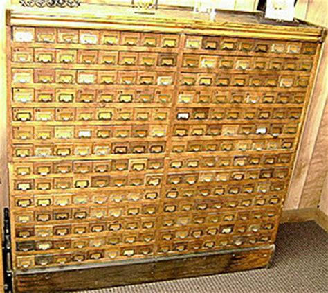 antique multi drawer wood parts cabinet gold