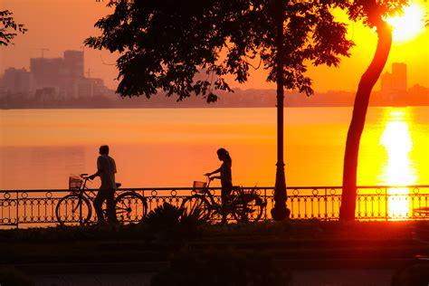 sunset   cyclists  hanoi vietnam image  stock