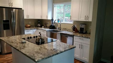 new caledonia granite white cabinets new caledonia granite countertops pictures cost pros