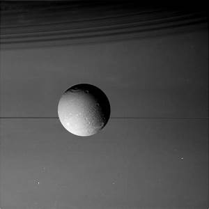 NASA probe makes last visit to Saturn's moon Dione ...